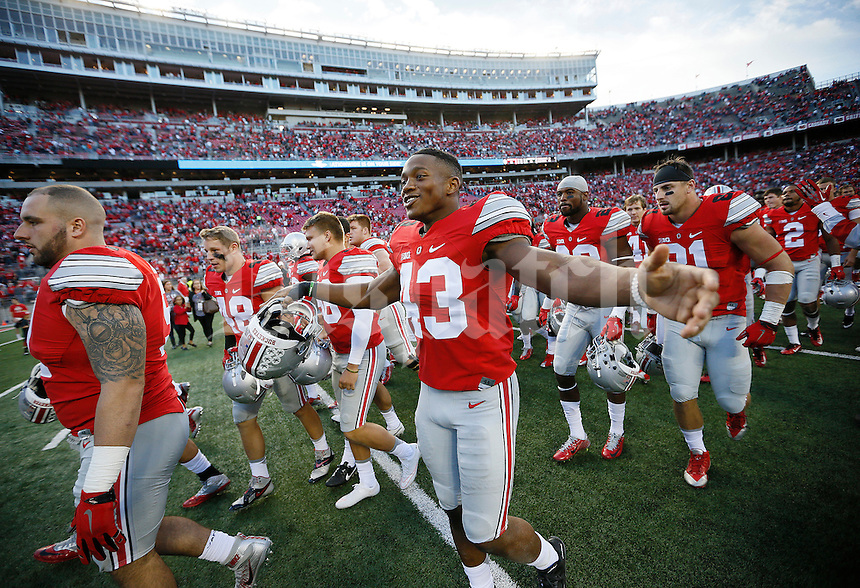 Ohio State Buckeyes linebacker Darron Lee (43) celebrates following Ohio State's 38-0 win over Hawaii in the NCAA football game at Ohio Stadium in Columbus on Sept. 12, 2015. (Adam Cairns / The Columbus Dispatch)