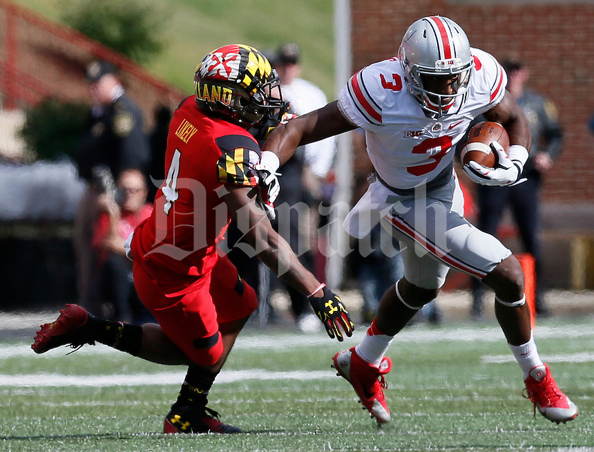 Ohio State Buckeyes wide receiver Michael Thomas (3) fends off Maryland Terrapins defensive back William Likely (4) in the fourth quarter of their game at Byrd Stadium in College Park, Maryland on October 4, 2014. (Columbus Dispatch photo by Brooke LaValley)