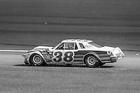 Sandy Satullo, #38 Buick, drives to pits after crashing, 1979 Firecracker 400 NASCAR race, Daytona International Speedway, Daytona Beach, FL, July 4, 1979.  (Photo by Brian Cleary/ www.bcpix.com )
