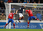 Farid El Allagui gets between Steven Whittaker and Dorin Goian to score for Falkirk as Rangers get eliminated from the Scottish Communities League Cup.