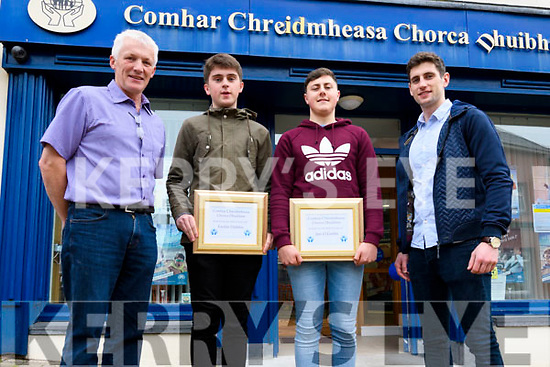 Faolan Daibhis and Jaic Ó Grifín who were awarded the Comhar Chreidmheasa Chorca Dhuibhne Third Level Education Bursaries, here pictured with Timmy Finn (chairman of the CCCD marketing committee) and Paul Geaney.