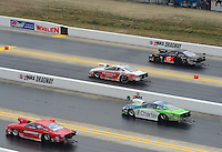 Apr. 15, 2012; Concord, NC, USA: NHRA pro stock drivers (from top) Erica Enders, Mike Edwards, Steve Kent and Grace Howell race during the first round of eliminations for the Four Wide Nationals at zMax Dragway. Mandatory Credit: Mark J. Rebilas-
