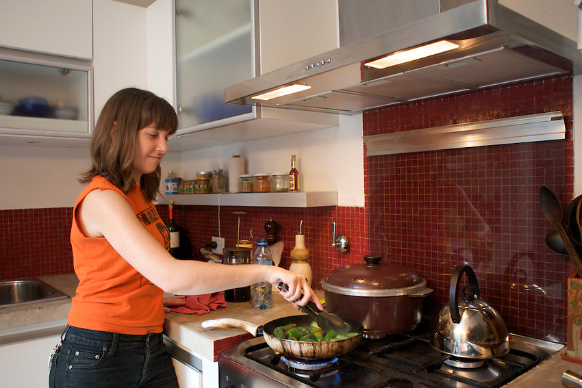In the kitchen with Liza Puglia aka Nola Chef as she prepares dinner at her closed door restaurant. <br /> <br /> Buenos Aires, Argentina. 2012.<br /> <br /> &copy; Clay Williams