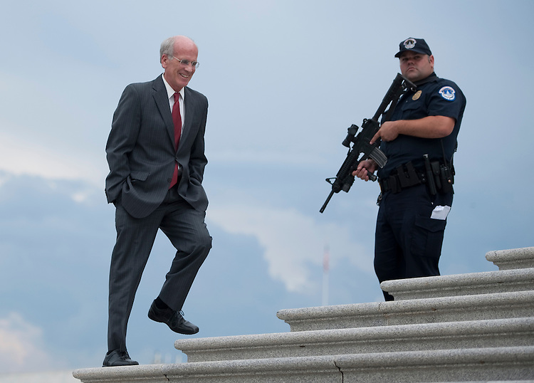 UNITED STATES - AUGUST 1: A U.S. Capitol Police officer keeps watch on the House steps as Rep. Peter Welch, D-Vt., arrives at the Capitol to vote on the debt ceiling bill in the House of Representatives on Monday, Aug. 1, 2011. (Photo By Bill Clark/Roll Call)