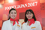 Members of staff pose for a photograph at the 42nd International Food and Beverage Exhibition (FOODEX JAPAN 2017) in Makuhari Messe International Convention Complex on March 8, 2017, Chiba, Japan. About 3,282 companies from 77 nations are participating in the Asia's largest food and beverage trade show. This year organizers expect 77,000 visitors for the four-day event, which runs until March 10. (Photo by Rodrigo Reyes Marin/AFLO)