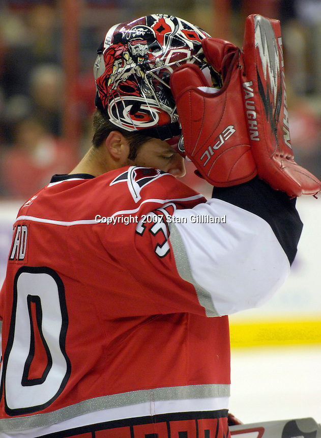 Carolina Hurricanes' goalie Cam Ward rests during a time stoppage in the first period of their game with Montreal Friday, Oct. 26, 2007 in Raleigh, NC. The Canadiens won 7-4.