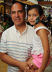 Victor Hernandez with Brenda,3, at the M.D. Anderson Back-to-School Fashion Show at the Galleria Saturday Aug. 16, 2014.(Dave Rossman photo)