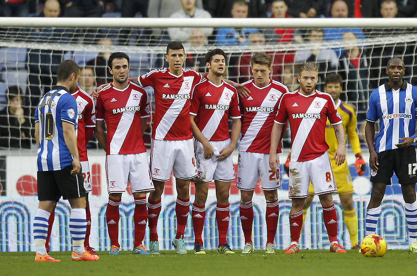 Middlesbrough's defence line upo for a free kick by Wigan Athletic's Shaun Maloney<br /> <br /> Photographer Mick Walker/CameraSport<br /> <br /> Football - The Football League Sky Bet Championship - Wigan Athletic v Middlesbrough - Saturday 22nd November 2014 - DW Stadium - Wigan<br /> <br /> &copy; CameraSport - 43 Linden Ave. Countesthorpe. Leicester. England. LE8 5PG - Tel: +44 (0) 116 277 4147 - admin@camerasport.com - www.camerasport.com