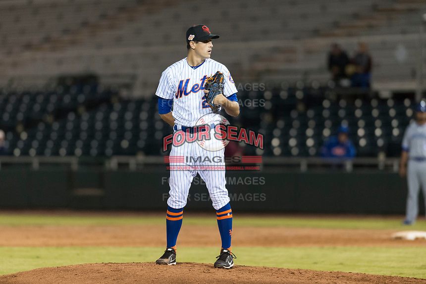 Scottsdale Scorpions relief pitcher Stephen Nogosek (29), of the New York Mets organization, looks in for the sign during an Arizona Fall League game against the Surprise Saguaros at Scottsdale Stadium on October 15, 2018 in Scottsdale, Arizona. Surprise defeated Scottsdale 2-0. (Zachary Lucy/Four Seam Images)