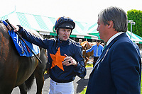 """Jockey Robert Havlin talks to connections of Dive for Gold in the winners enclosure after winning The Willton Homes """"Confined"""" Novice Stakes (Colts & Geldings) during Afternoon Racing at Salisbury Racecourse on 17th May 2018"""