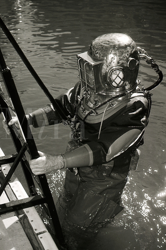 Commercial diver in old style heavy gear (deep sea diver).
