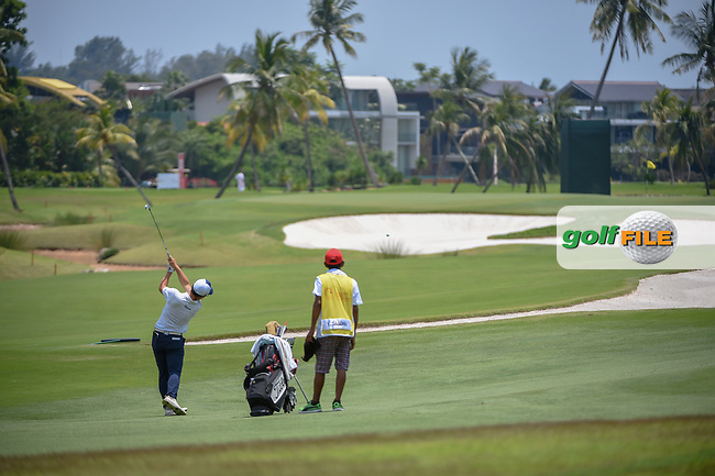 Bryan Wiyang TEOH (MAS) hits his approach shot on 16 during Rd 1 of the Asia-Pacific Amateur Championship, Sentosa Golf Club, Singapore. 10/4/2018.<br /> Picture: Golffile | Ken Murray<br /> <br /> <br /> All photo usage must carry mandatory copyright credit (© Golffile | Ken Murray)