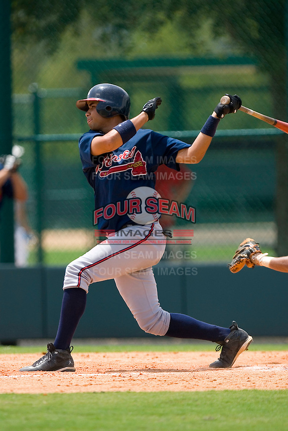 Fernando De Los Santos #14 of the GCL Braves follows through on his swing versus the GCL Phillies at Disney's Wide World of Sports Complex, July 13, 2009, in Orlando, Florida.  (Photo by Brian Westerholt / Four Seam Images)