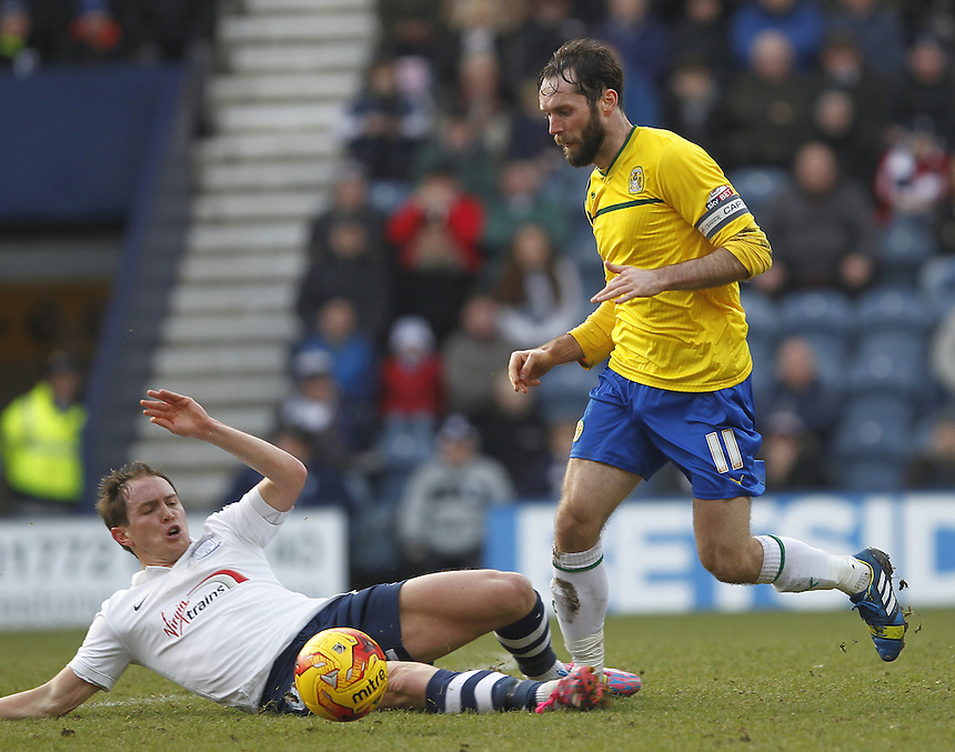 Preston North End's Neil Kilkenny tackles Coventry City's James O'Brien<br /> <br /> Photographer Mick Walker/CameraSport<br /> <br /> Football - The Football League Sky Bet League One - Preston North End v Coventry City - Saturday 7th February 2015 - Deepdale - Preston<br /> <br /> &copy; CameraSport - 43 Linden Ave. Countesthorpe. Leicester. England. LE8 5PG - Tel: +44 (0) 116 277 4147 - admin@camerasport.com - www.camerasport.com