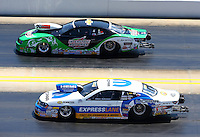 Sep 14, 2013; Charlotte, NC, USA; NHRA pro stock driver Allen Johnson (near) races alongside Mike Edwards during qualifying for the Carolina Nationals at zMax Dragway. Mandatory Credit: Mark J. Rebilas-