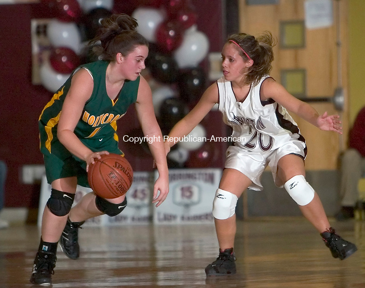 TORRINGTON, CT-- 14 FEBRUARY 2008--021408JS06-Holy Cross' Sarah Ciarleglio (11) is guarded by Torrington's Kaylee Cerruto (20) during their game Thursday at Torrington High School. <br /> Jim Shannon/Republican-American