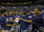 Nevada celebrates with their trophy after defeating Colorado State for the MW championship in an NCAA college basketball game in Reno, Nev., Sunday, Feb. 25, 2018. (AP Photo/Tom R. Smedes)
