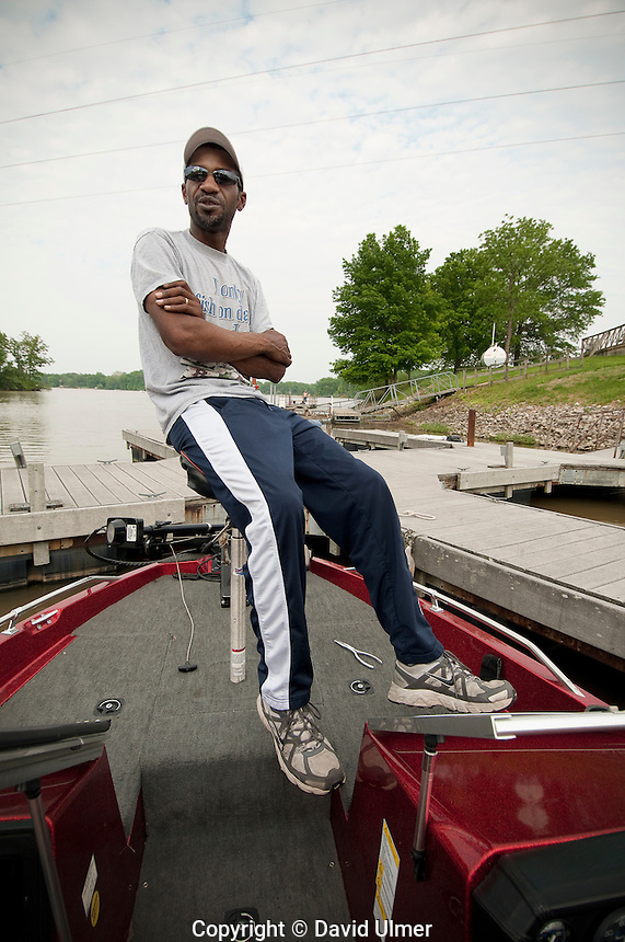 African American man in his bass boat before the start of a fishing tournament.