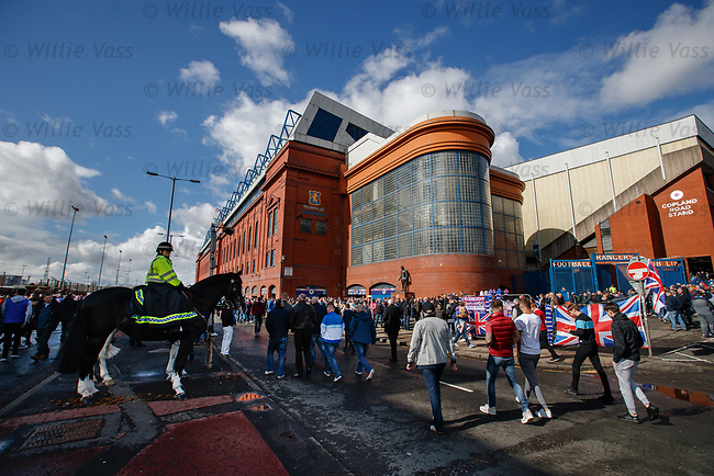 Supporters arriving for the match at Ibrox Stadium this afternoon