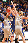 SIOUX FALLS, SD - MARCH 11:  xxxxxxxxx #11 from IPFW tries to split the defense of Hannah Strop #14 and Mariah Clarin #40 from South Dakota State in the second half of their semifinal game Monday afternoon at the 2013 Summit League Tournament in Sioux Falls, SD.  (Photo by Dave Eggen/Inertia)