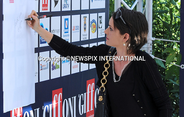 "WYONA RYDER.at the  Giffoni Film Festival , Giffoni, Salerno, Italy.The Giffoni International Film Festival is the largest children's film festival in Europe. Over 1000 children attend the festival from 30 countries around the world. During the festival, the children and teenagers watch the films, learn about the filmmaking process, and are called to judge them and award the best ones with prizes..Mandatory Credit Photo: ©NEWSPIX INTERNATIONAL..**ALL FEES PAYABLE TO: ""NEWSPIX INTERNATIONAL""**..IMMEDIATE CONFIRMATION OF USAGE REQUIRED:.Newspix International, 31 Chinnery Hill, Bishop's Stortford, ENGLAND CM23 3PS.Tel:+441279 324672  ; Fax: +441279656877.Mobile:  07775681153.e-mail: info@newspixinternational.co.uk"