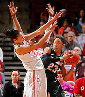 Ohio State Buckeyes forward Martina Ellerbe (23) and Ohio State Buckeyes guard Raven Ferguson (31) force Michigan State Spartans guard Aerial Powers (23) to throw the ball away during the first half of their NCAA basketball game at Value City Arena in Columbus, Ohio on January 26, 2014.  (Dispatch photo by Kyle Robertson)