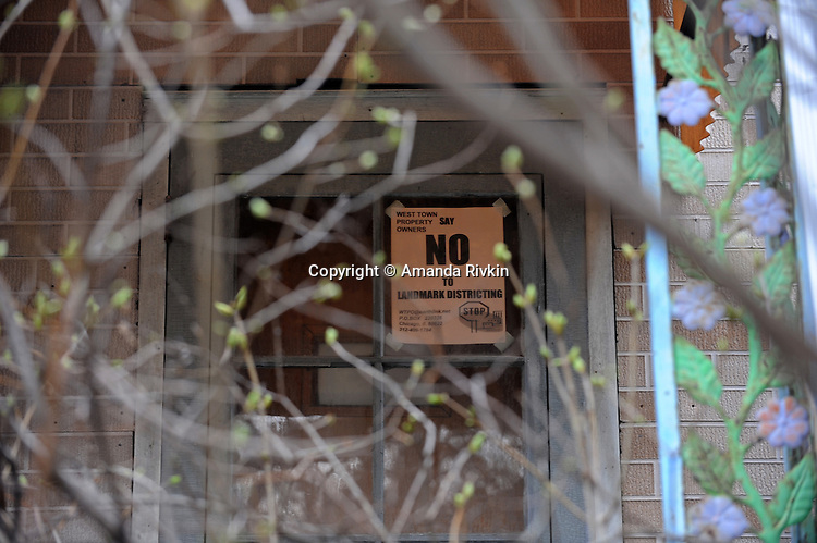 A sign of protest hangs on a non-landmarked home in the East Village section of West Town, on Chicago's Near Northwest Side where some landmark distinctions are viewed as dubious in Chicago, Illinois on March 23, 2009.