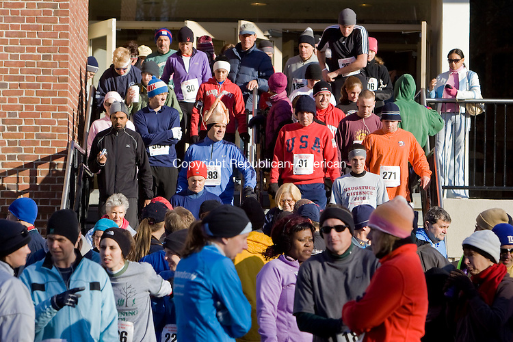 WATERBURY, CT - 23 NOVEMBER 2008 -112308JT02-<br /> Runners for the annual Fischang-Cicchetti Memorial Five-Mile Run pour out of the Waterbury YMCA as the starting time approaches on Sunday morning. The first male finisher was 38-year-old Joseph Ekuom of the Bronx, NY, with a time of 24:52. The first female finisher was Brett Romano Ely of Natick, Mass. with a time of 29:02.<br /> Josalee Thrift / Republican-American