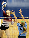 SIOUX FALLS, SD - DECEMBER 8:  Christine Carroll #13 from the University of South Carolina Aiken tries to get a kill past the defense of Ally Rohn #22 from Palm Beach Atlantic during their quarterfinal match of the NCAA DII Volleyball Championships at the Sanford Pentagon in Sioux Falls, SD. (Photo by Dave Eggen/Inertia)