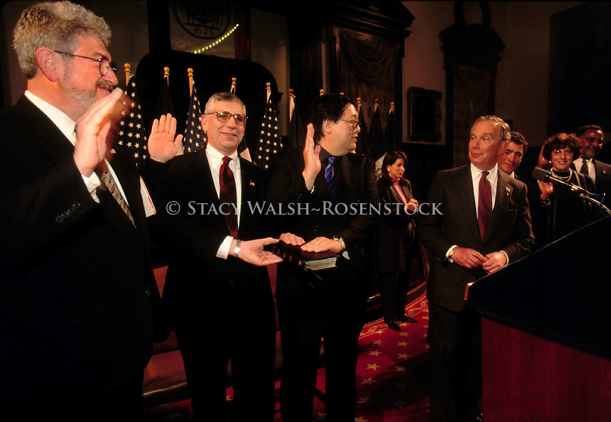 (020101-SWR08.jpg) New York, NY -- 1 Jan 02 -- Immdeiately following his inaugural reception, New York City Mayor Mike Bloomberg reappointed and swore in 20 Manhattan Judges. At left are Judges William M Erlbaum,  Leonard P Rienzi and Douglas S Wong, of Manhattan Criminal Court, with Bloomberg at left. Also reappointed were interim Civil Court Judges Richard M Allman, Ellen M Coin, Lenora Gerald, Susan K Knipps, Jeffrey D Leibowitz, Judith Lieb, Robert M Stoltz, Criminal Court Judges Peter M Benitez, Dennis J Boyle, Laura E Drager, Thomas A Farber, Jo Ann Ferninand, Daniel P Fitzgerald, Roger S Hayes, Leslie G Leach, Seth L Martin, Michael L Sonberg, were also reappointed and sworn in...Photo © Stacy Walsh Rosenstock