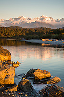 Sunset over Southern Alps reflecting in Gillespies Lagoon, Westland Tai Poutini National Park, West Coast, South Westland, UNESCO World Heritage Area, New Zealand, NZ