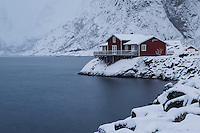 Traditional red seaside Rorbu cabins in winter, Toppøy, Reine Moskenesøy, Lofoten Islands, Norway