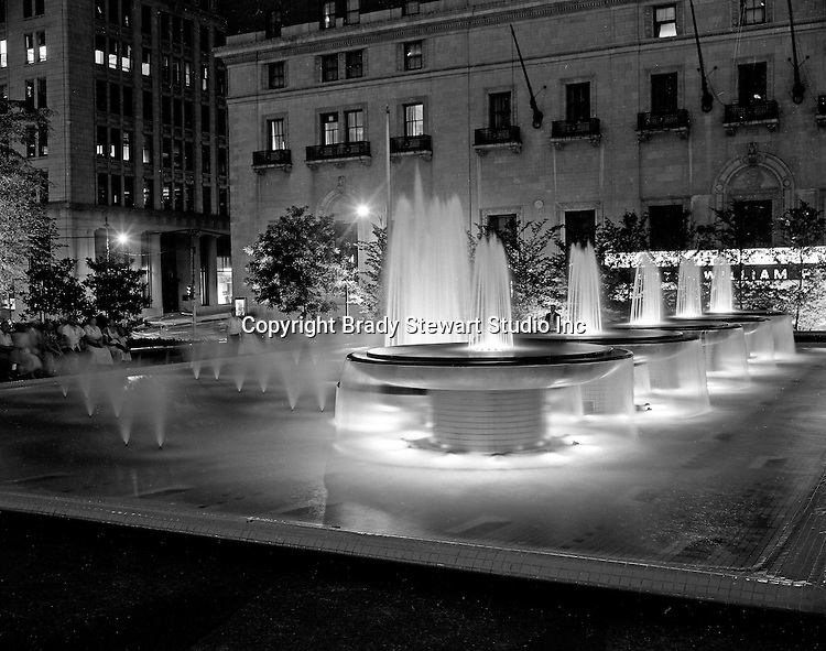 A view of the New Mellon Square at Night - 1955. Mellon Square, built in 1953-55 was designed by Mitchell & Ritchey, landscaped by Simonds & Simonds, and paid for by Mellon family foundations.  Rumor has it that the park was built to keep Alcoa Corporation from moving from Pittsburgh to New York City in the early 1950s.  Other building in the photo include:  William Penn Hotel in background.