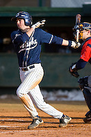 Griffin Wise #22 of the Catawba Indians follows through on his swing versus the Shippensburg Red Raiders on February 14, 2010 in Salisbury, North Carolina.  Photo by Brian Westerholt / Four Seam Images