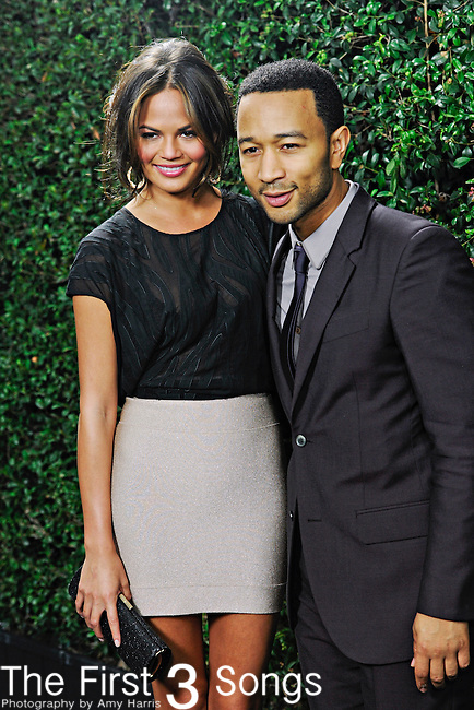 John Legend and girlfriend Chrissy Teigen attend the 2010 American Music Awards VIP After Party hosted by Rolling Stone Magazine at the Rolling Stone Restaurant & Lounge in Los Angeles, California.