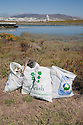 "Full trash bags at Bayfront Park. Volunteers in the City of Millbrae participated in California Coastal Cleanup Day on 9/19/09. Participants cleaned up inland locations throughout the city as well as at Bayfront Park on the San Francisco Bay shoreline. The inland cleanup efforts were important because, according to the California Coastal Commission, ""past Coastal Cleanup Day data tell us that most (between 60-80 percent) of the debris on our beaches and shorelines comes from inland sources, traveling through storm drains or creeks out to the beaches and ocean. Rain or even something as simple as hosing down a sidewalk can wash cigarette butts, bits of styrofoam, pesticides, and oil into the storm drains and out to the ocean."" The California Coastal Cleanup Day (http://www.coastal.ca.gov/publiced/ccd/ccd.html) is sponsored by the California Coastal Commission and is a part of the International Coastal Cleanup organized by The Ocean Conservancy."