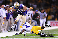 Sept. 5, 2009; Seattle, WA, USA; Washington Huskies wide receiver (9) Devin Aguilar leaps over LSU Tigers cornerback (4) Jai Eugene in the fourth quarter at Husky Stadium. Mandatory Credit: Mark J. Rebilas-