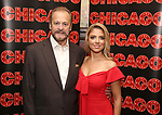 Producer Barry Weissler and Shiri Maimon attends a photo call for her Broadway debut as Roxie Hart in 'Chicago' on September 7, 2018 at Sardi's in New York City.