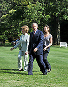 Washington, D.C. - August 11, 2008 -- United States President George W. Bush, accompanied by his wife, Laura, and daughter, Barbara, returns to the White House from a trip to Asia on Monday, August 11, 2008.<br /> Credit: Ron Sachs / Pool via CNP