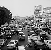 Tijuana, Mexico.August 19, 2007<br /> <br /> The Mexican US border crossing from the Mexican side as people wait many hours to cross in to the US on a Sunday. The crossing is the busiest border crossing in the world and lines to wait for US entry are often many hours.<br /> <br /> Vendors and trinket shops take advantage of the bored potential customers.