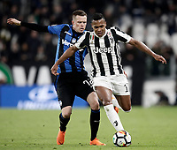 Calcio, Serie A: Juventus - Atalanta, Torino, Allianz Stadium, 14 marzo 2018. <br /> Juventus' Alex Sandro (r) in action with Atalanta's Josip Ilicic (l) during the Italian Serie A football match between Juventus and Atalanta at Torino's Allianz stadium, March 14, 2018.<br /> UPDATE IMAGES PRESS/Isabella Bonotto