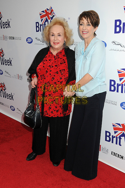 Doris Roberts, Patricia Heaton.BritWeek 2012 Official Launch held at a Private Residence, Los Angeles, California, USA..April 24th, 2012.full length black trousers blue blouse red print.CAP/ADM/BP.©Byron Purvis/AdMedia/Capital Pictures.