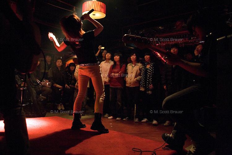 Ruan Ruan, singer for the Chinese punk band Overdose, performs in a concert in Castle Bar in Nanjing, Jiangsu, China.