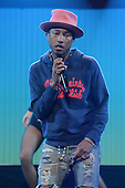 SUNRISE, FL - DECEMBER 21: Pharrell performs during the Y100's Jingle Ball 2014 at BB&T Center on December 21, 2014 in Miami, Florida. Credit Larry Marano (C) 2014