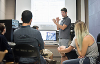 Professor Adam Schoenberg teaches his film scoring class in the electronic music studio, Booth 200, on Oct. 27, 2015.<br /> (Photo by Marc Campos, Occidental College Photographer)
