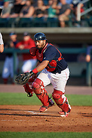 Lowell Spinners catcher Alberto Schmidt (20) tracks down a loose ball during a game against the Vermont Lake Monsters on August 25, 2018 at Edward A. LeLacheur Park in Lowell, Massachusetts.  Vermont defeated Lowell 4-3.  (Mike Janes/Four Seam Images)
