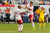Jamison Olave (4) of the New York Red Bulls celebrates scoring with Tim Cahill (17). The New York Red Bulls and the Columbus Crew played to a 2-2 tie during a Major League Soccer (MLS) match at Red Bull Arena in Harrison, NJ, on May 26, 2013.