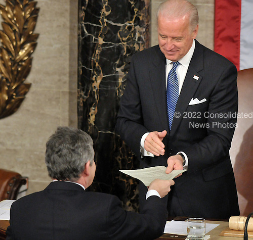 Washington, DC - March 4, 2009 -- The Right Honorable Gordon Brown, M.P., Prime Minister of the United Kingdom, hands a copy of his speech to United States Vice President Joseph Biden prior to addressing a Joint Session of the U.S. Congress in the U.S. Capitol in Washington, D.C. on Wednesday, March 4, 2009..Credit: Ron Sachs / CNP