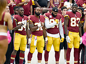 Washington Redskins players stand at attention as the National Anthem is played prior to the game against the San Francisco 49ers at FedEx Field in Landover, Maryland on Sunday, October 15, 2017.  From left to right: former center Jeff Bostic; running back Mack Brown (34); running back Samaje Perine (32); tight end Niles Paul (84) and wide receiver Brian Quick (83).<br /> Credit: Ron Sachs / CNP