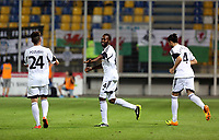 Thursday 29 August 2013<br /> Pictured: Roland Lamah of Swansea (C) celebrating his goal with team mates Alejandro Pozuelo (L) and Chico Flores (R)<br /> Re: Petrolul Ploiesti v Swansea City FC UEFA Europa League, play off round, 2nd leg, Ploiesti, Romania.
